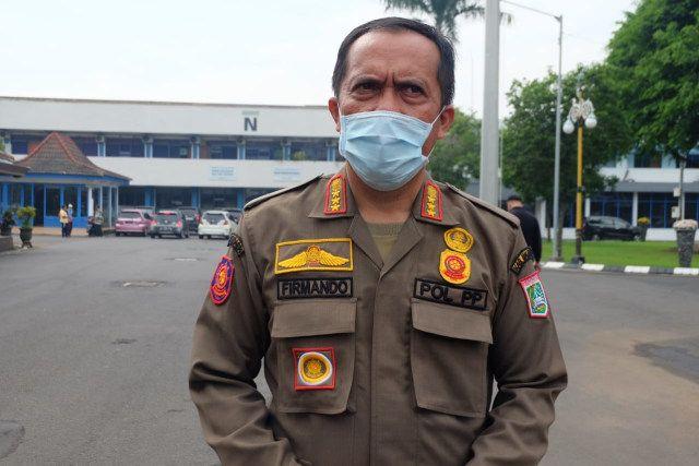 Sekretaris Satpol PP Kabupaten Malang, Firmando Matondang saat menjelaskan soal PPKM mikro. (Foto: Rap/Tugu Jatim)