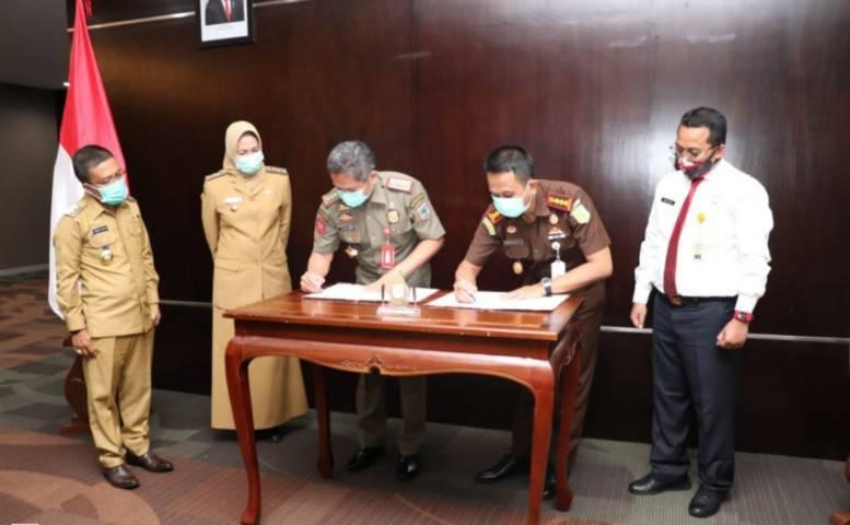 Penandatanganan kerja sama penegakan perda di Balai Kota Among Tani Kota Batu (Foto: Diskominfo Kota Batu/Tugu Jatim)