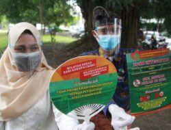 Sosialiasi yang dilakukan oleh Kemenag Kota Malang untuk cegah gratifikasi di Alun-Alun Kota Malang, Jumat (9/4/2021). (Foto: Rubianto/Tugu Malang/Tugu Jatim)