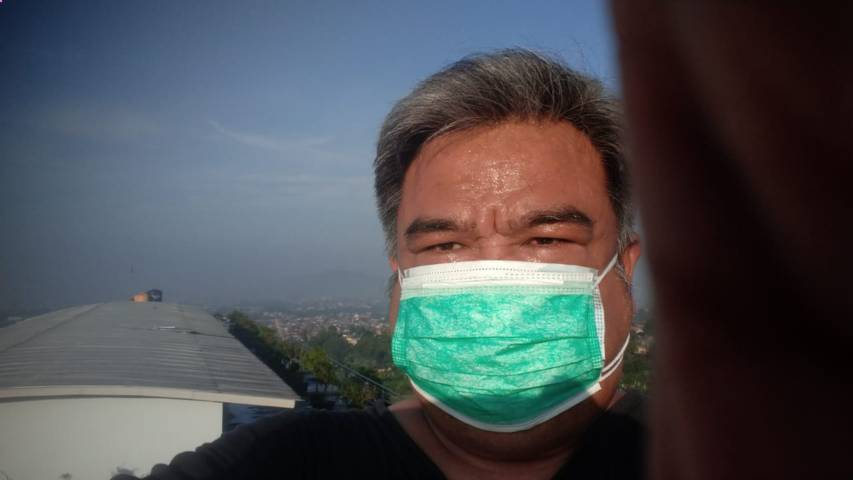 Erwin Kustiman saat melawan virus Covid-19. (Foto: Dokumen/Tugu Jatim)