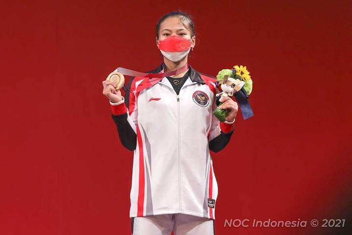 Atlet angkat besi Indonesia, Windy Cantika Aisah, mengaku senang dan bangga bisa menyumbangkan medali pertama untuk Indonesia di ajang Olimpiade Tokyo 2020. (Foto: Nocindonesia/Tugu Jatim)