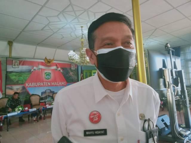 Sekretaris Daerah (Sekda) Kabupaten Malang, Wahyu Hidayat menyatakan bahwa penanganan pandemi di Kabupaten Malang menerapkan PPKM Level 4 meski sebenarya masuk penyebarannya hanya berada pada Level 3. (Foto: Rizal Adhi/Tugu Malang/Tugu Jatim)